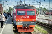 St. Petersburg, Russia - August 23, 2013: Modern Red Suburban Electric Train Standing At The Station