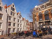 Amsterdam, Netherlands - March 19, 2014: Ordinary Outdoor Cafe. Ordinary People Drink Coffee And Eat
