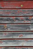 Old weathered red wood siding