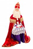Sitting Sinterklaas . isolated on white background. Dutch character of Santa Claus