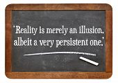 reality is merely an illusion, albeit a very persistent one - a quote from Albert Einstein on a vint