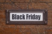 Black Friday  - file cabinet label, bronze holder against grunge and scratched wood