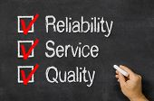 Blackboard with a checklist Reliability Service and Quality