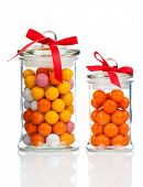 Colorful Background Of Assorted Gumballs In  Glass Jar,  Isolated Over White Background