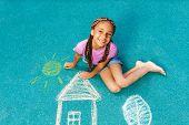 Nice black girl with chalk drawing