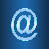 Abstract E-mail At Symbol In The Neon Light On Blue Background