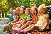 pic of sitting a bench  - Close group portrait of little kids - JPG