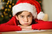Little girl waiting for santa at home in the living room