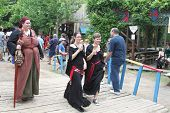 MUSKOGEE, OK - MAY 24: Actors in historical costume walk in the parade of the Oklahoma 19th annual Renaissance Festival on May 24, 2014 at the Castle of Muskogee in Muskogee, OK.