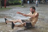 MUSKOGEE, OK - MAY 24: Grown men play in water and mud after rain at the Oklahoma 19th annual Renais