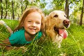 Little blond girl with her retriever dog