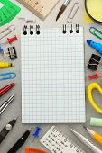 notebook and school accessories at old background texture