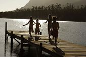 stock photo of dock a lake  - Kids Running on Dock - JPG