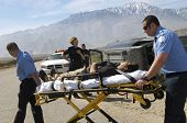 Paramedics transporting victim on stretcher