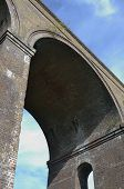 Looking up at viaduct arch