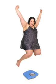 stock photo of nighties  - Large girl in nightie jumping over a scale isolated in white - JPG