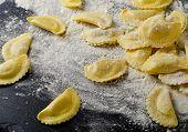 Italian Raw  Ravioli On   Black Table