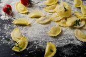 Italian Raw  Ravioli On  A  Black Table