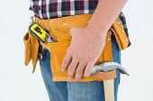 Close-up of male repairman wearing tool belt on white background