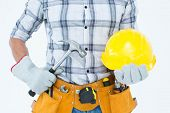 Cropped image of handyman holding hammer and hard hat over white background