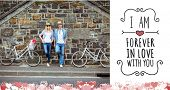 Hip young couple standing by brick wall with their bikes against valentines message