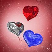 Heart balloons against red vignette