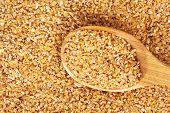 wheat porridge on a wooden spoon