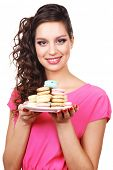 Young beautiful girl with tasty macaroon isolated on white on background