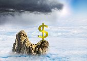 Dollar Sign On A Mountain Top Among The Clouds, Concept