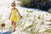 Portrait of charming little girl outdoors on vacation