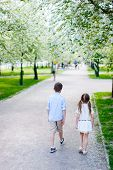 Brother and sister outdoors in a beautiful park on spring day