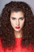 Beautiful young fashion woman with long curly hairs