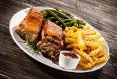 Grilled ribs, chips and vegetables