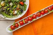 Long Dish With Cherry Tomatoes And A Green Salad