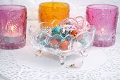 Jewelry earrings in a glass vase with candles