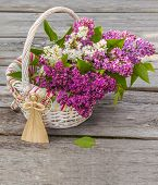 Bouquet Of Lilac And Straw Angel On A Wooden  Table