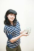 Smiling Brunette Girl Showing Money In Hands