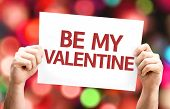 Be My Valentine card with colorful background with defocused lights