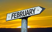 February sign with a sunset background