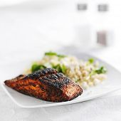 salmon filet with quinoa and arugala