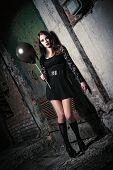 Strange Young Girl Holding Black Balloon