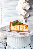 Cheese cake on paper napkin in plate on wooden background