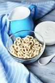 Homemade yogurt and delicious  cereals in bowl on wooden table background