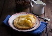 stock photo of crepes  - Pancakes or crepes on plate on wooden background - JPG
