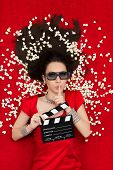 Girl with 3D Cinema Glasses,  Popcorn and Director Clapboard Asking for Silence