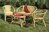 Set Of Rattan Furniture For Balcony And Garden On Green Grass In The Yard