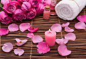 Candles and rose Petals ,towel, salt in bowl on mat