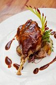foto of roast duck  - Duck pestle with potato and garlic - JPG