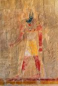 image of embalming  - ancient egypt color image of anubis on wall in luxor - JPG