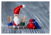 Christmas Concept - Clothespin. Santa Claus With Kids And Gifts. Father Frost. Papa Noel. (soft Focu